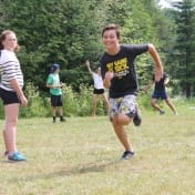 Running in mid stride on the play field at Can-Aqua
