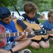 These boys prepare for their guitar class