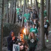 The Terrus leader guides his team with a torch