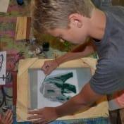 A Can-Aqua artist prepares his sketch